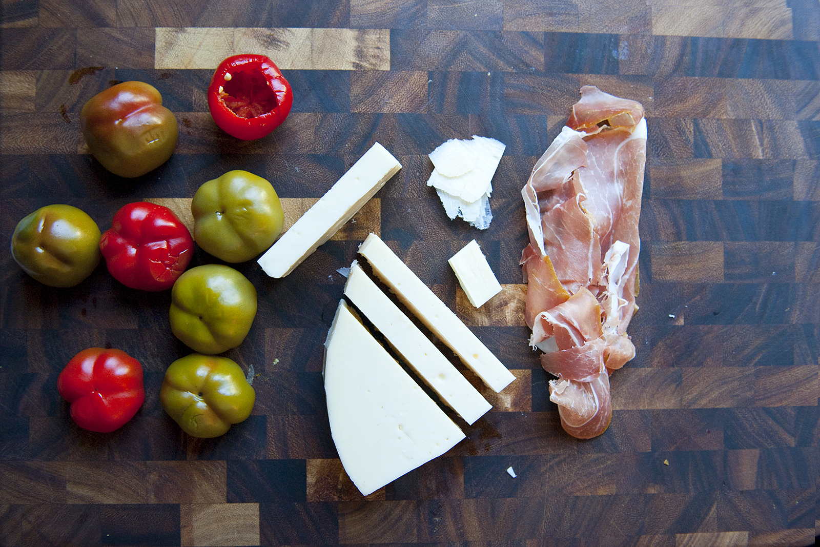 Cherry peppers, cheese, prosciutto cutting board